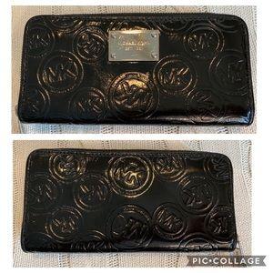 Michael Kors black zippered wallet.